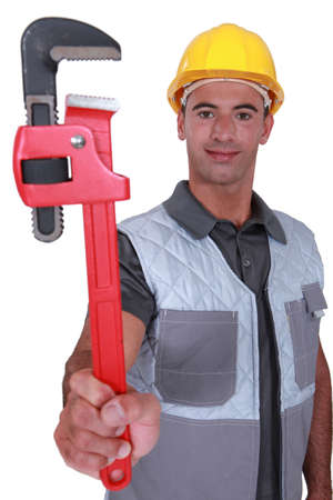plumber showing spanner Stock Photo - 16779377
