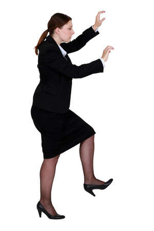 upward struggle: Woman pretending to climb