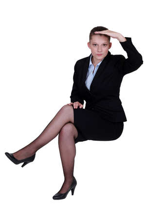 nylons: Businesswoman peering into the distance Stock Photo
