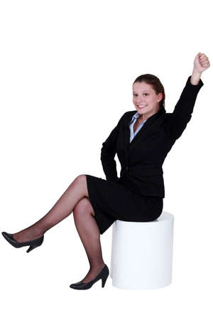 Businesswoman reaching into the air photo