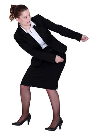 dominate: woman in a suit pulling something