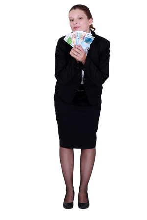 Businesswoman holding euro bank notes photo