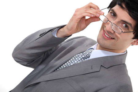 Businessman removing glasses photo