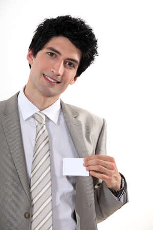Businessman confidently presenting card Stock Photo - 16808419