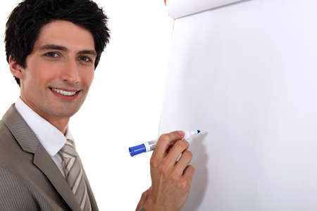 Man writing on flip chart Stock Photo - 16808162