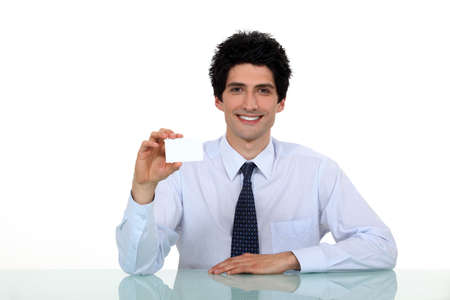Businessman showing business card Stock Photo - 16807605