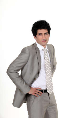 portrait of classy businessman with hands resting on waist Stock Photo - 16808371