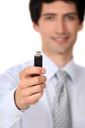 Businessman holding a usb key Stock Photo - 16806640