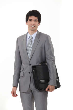 A businessman carrying his briefcase Stock Photo - 16808117