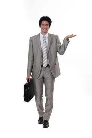 businessman presenting something Stock Photo - 16805988