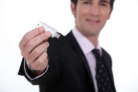 microdrive: businessman holding a flash drive