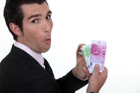 Rich businessman showing off his money photo