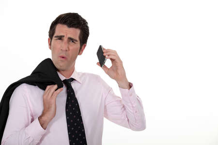 Businessman taking a bad phone call Stock Photo - 16808075