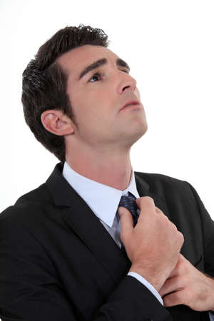 Man straightening tie Stock Photo - 16808267
