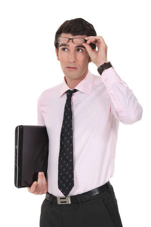 demanding: Businessman raising his glasses Stock Photo