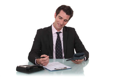 numerate: Happy businessman with a calculator