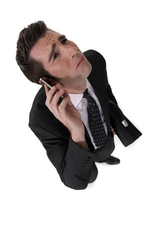 Businessman taking a bad phone call Stock Photo - 16805779