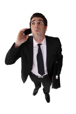 heaviness: Man blowing with mobile phone