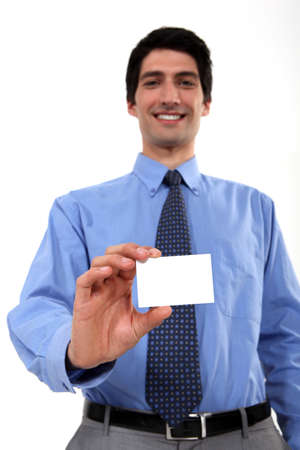 businessman with toothy smile showing business card Stock Photo - 16806649