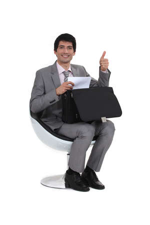 non verbal communication: Businessman giving the thumb