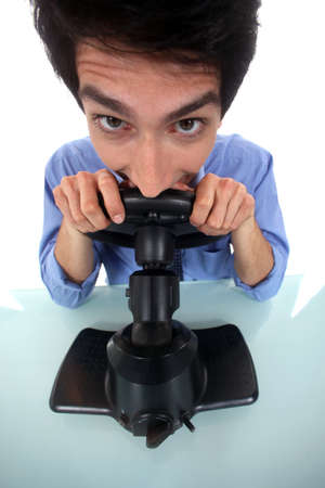 horsing around: Man pretending to play a console Stock Photo