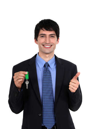 Car salesmen holding keys photo