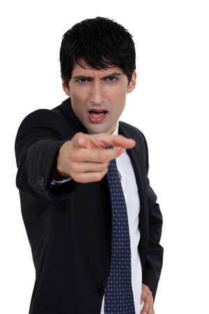 reprimanding: Angry businessman pointing at you