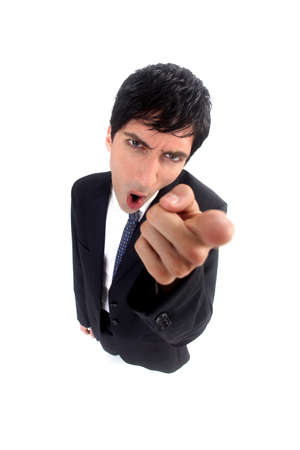 empresario enojado: hombre de negocios enojado que se�ala Foto de archivo