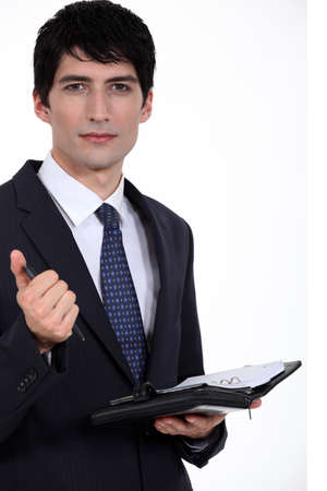 A businessman about to write on his agenda  photo