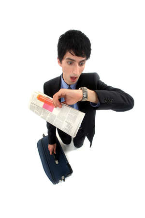 stunned: Stunned businessman looking at the time