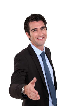 Businessman offering you his hand Stock Photo - 16807237