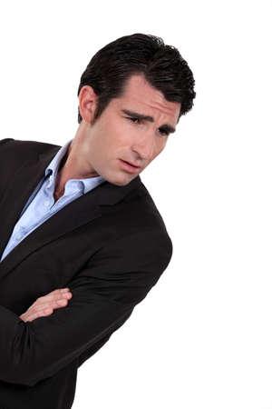 wrinkled brow: Man knitting his eyebrows