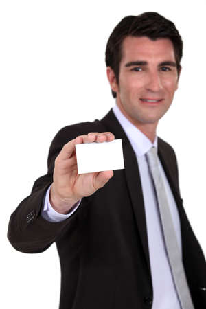 Man holding up a blank business card Stock Photo - 16805681