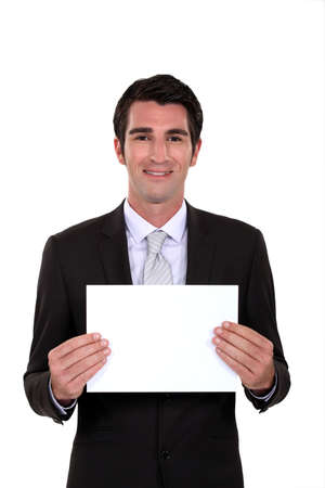 A businessman holding a blank poster  Stock Photo - 16805883