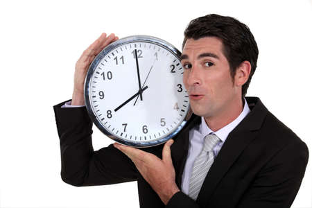 Businessman holding clock Stock Photo - 16807966