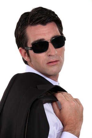 straight faced: Man wearing dark sunglasses