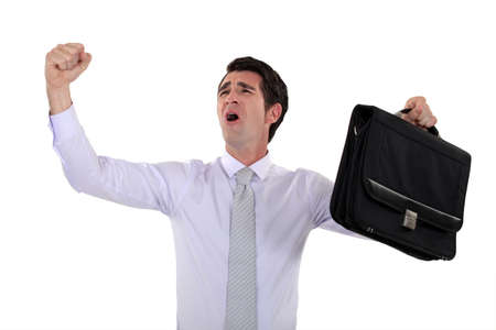 happy businessman raising hands photo