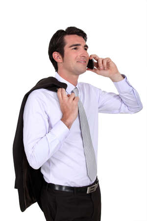 blithe: Businessman talking on his mobile phone Stock Photo