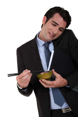 Businessman eating Chinese food photo