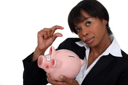 american money: Businesswoman saving for a rainy day