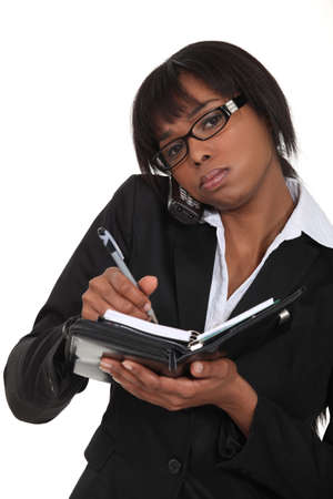 event planner: A busy black businesswoman  Stock Photo