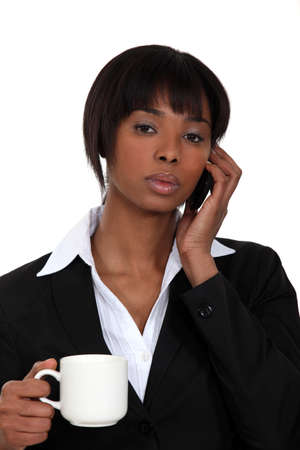 Serious businesswoman on the phone Stock Photo - 16807549