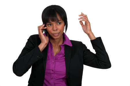 Annoyed businesswoman on the phone Stock Photo - 16805677