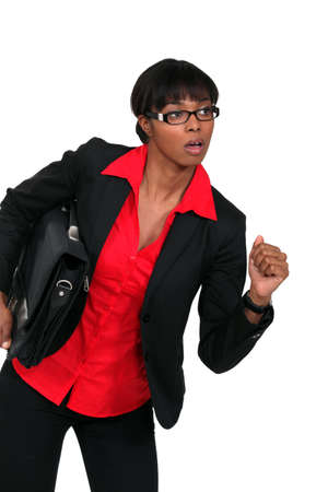 Businesswoman running with a briefcase Stock Photo - 16805991