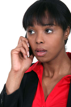 An African American businesswoman getting bad news  photo