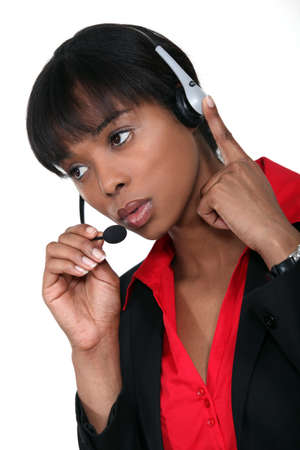 telephony: African American woman answering the hotline