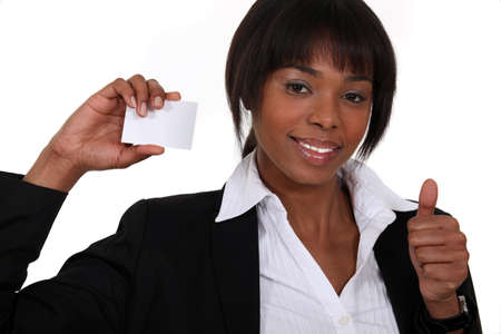 Businesswoman holding up her business card Stock Photo - 16808074