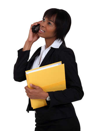 Afro-American businesswoman talking on her cell Stock Photo - 16805875