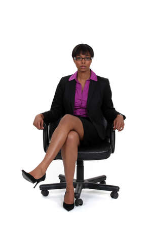 legs open: Woman sitting in a swivel chair