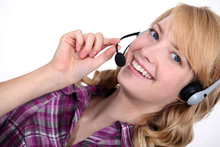 Blond with a headset on  Stock Photo - 16808372